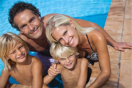 Family relaxing together in swimming pool, portrait Stock Photo - Premium Royalty-Free, Code: 632-05816445