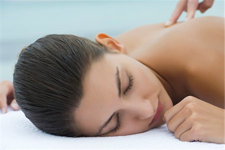 Young woman receiving massage, cropped Stock Photo - Premium Royalty-Free, Code: 632-05816447