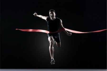 finish line - Runner crossing finish line Stock Photo - Premium Royalty-Free, Code: 632-05816465