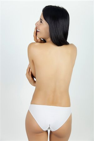 Woman standing in underwear, rear view Stock Photo - Premium Royalty-Free, Code: 632-05816468