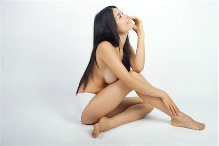 slim - Woman sitting in underwear, daydreaming Stock Photo - Premium Royalty-Free, Code: 632-05816491