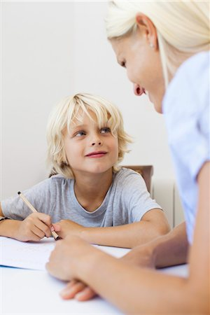 Mother helping son with homework Stock Photo - Premium Royalty-Free, Code: 632-05816507