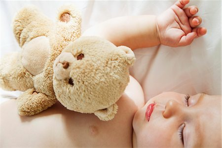 Baby sleeping with teddy bear Stock Photo - Premium Royalty-Free, Code: 632-05816510