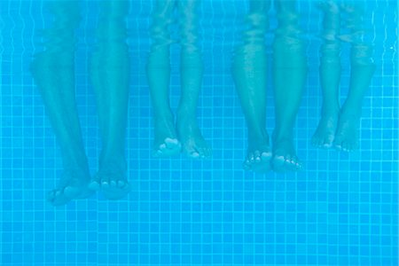dangling - Family soaking feet in pool, underwater view Stock Photo - Premium Royalty-Free, Code: 632-05816524