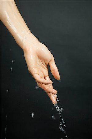 Hand under running water Stock Photo - Premium Royalty-Free, Code: 632-05816631