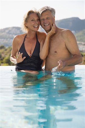 Mature couple relaxing together in pool Stock Photo - Premium Royalty-Free, Code: 632-05816707