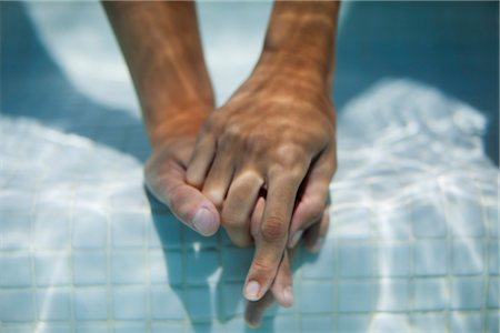 refraction - Couple holding hands underwater, cropped Stock Photo - Premium Royalty-Free, Code: 632-05816728