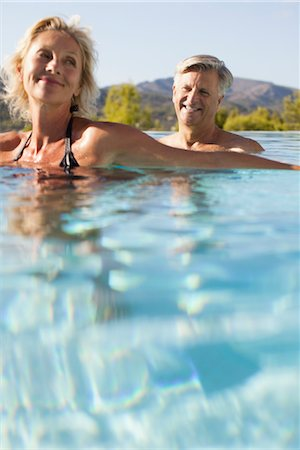 refraction - Mature couple relaxing in pool Stock Photo - Premium Royalty-Free, Code: 632-05816732