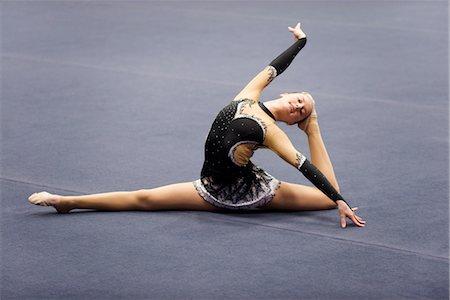 feet gymnast - Female gymnast performing floor routine Stock Photo - Premium Royalty-Free, Code: 632-05816796