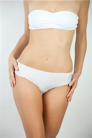 slim - Woman standing in underwear, cropped Stock Photo - Premium Royalty-Free, Code: 632-05816809