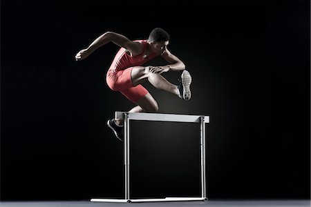 runner (male) - Male athlete clearing hurdle Stock Photo - Premium Royalty-Free, Code: 632-05816829