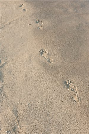 Footprints in sand, high angle view Stock Photo - Premium Royalty-Free, Code: 632-05816821