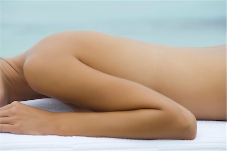 Topless woman lying on stomach on massage table, mid section Stock Photo - Premium Royalty-Free, Code: 632-05816893