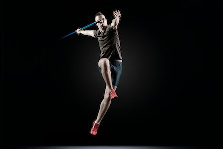 Male athlete leaping with javelin Stock Photo - Premium Royalty-Free, Code: 632-05816937