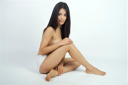 Woman sitting in underwear, full length portrait Stock Photo - Premium Royalty-Free, Code: 632-05816966