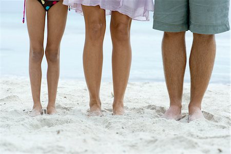 Family standing on beach, low section Stock Photo - Premium Royalty-Free, Code: 632-05816997