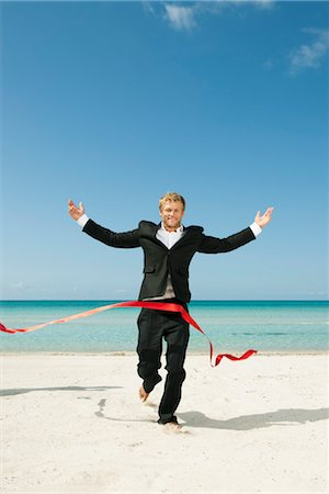 finish line - Young businessman running on beach towards finishing line Stock Photo - Premium Royalty-Free, Code: 632-05817007