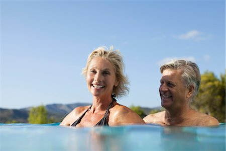 Mature couple relaxing together in pool Stock Photo - Premium Royalty-Free, Code: 632-05817023