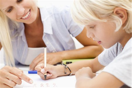 Mother helping son with homework Stock Photo - Premium Royalty-Free, Code: 632-05817041