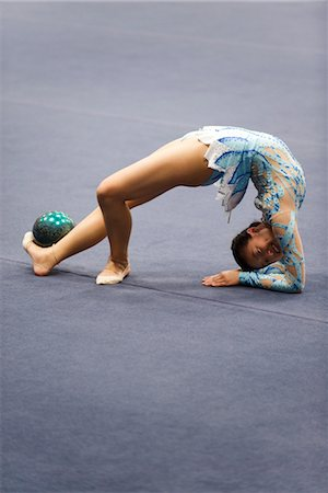 feet gymnast - Female gymnast performing floor routine with ball Stock Photo - Premium Royalty-Free, Code: 632-05817058
