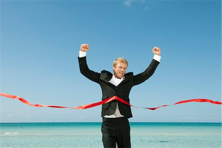 finish line - Young businessman crossing finishing line Stock Photo - Premium Royalty-Free, Code: 632-05817063