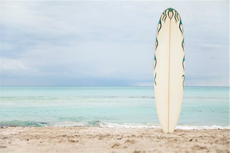 recreation - Surfboard stuck in sand at the beach Stock Photo - Premium Royalty-Free, Code: 632-05817075