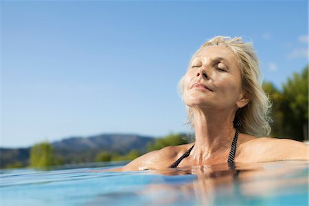 Mature woman relaxing in pool with eyes closed Stock Photo - Premium Royalty-Free, Code: 632-05817089