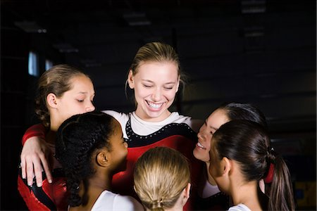 preteen girls gymnastics - Team of female gymnasts embracing Stock Photo - Premium Royalty-Free, Code: 632-05817119