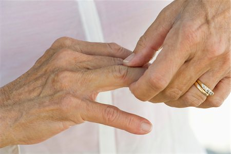 ring hand woman - Senior woman rubbing knuckles, cropped Stock Photo - Premium Royalty-Free, Code: 632-05817127