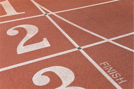 finish line - Lanes of running track, focus on lane two Stock Photo - Premium Royalty-Free, Code: 632-05817134
