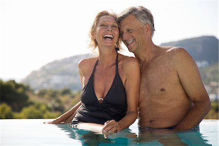 Mature couple relaxing together in pool Stock Photo - Premium Royalty-Free, Code: 632-05817135