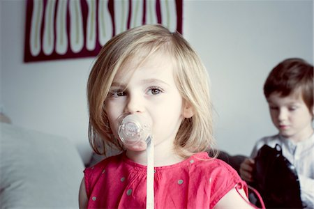sucking - Little girl sucking pacifier Stock Photo - Premium Royalty-Free, Code: 632-05817153