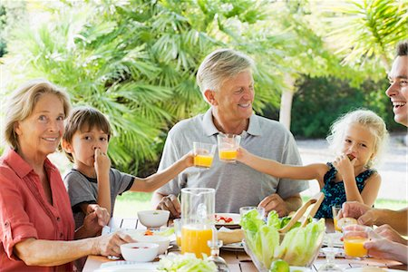 family table eating together - Multi-generation family enjoying meal outdoors Stock Photo - Premium Royalty-Free, Code: 632-05845160