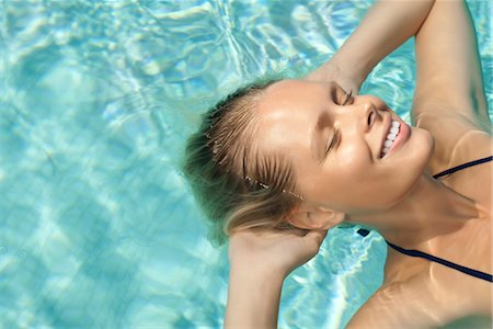 refraction - Woman floating in pool with eyes closed Stock Photo - Premium Royalty-Free, Code: 632-05845229