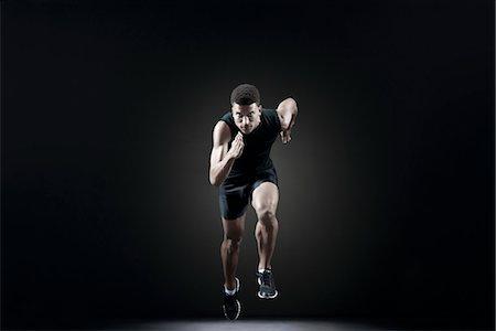 sprint - Male athlete leaving starting line Stock Photo - Premium Royalty-Free, Code: 632-05845239