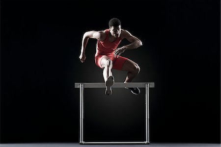runner (male) - Male athlete clearing hurdle Stock Photo - Premium Royalty-Free, Code: 632-05845551