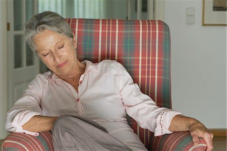 Senior woman napping in armchair Stock Photo - Premium Royalty-Free, Code: 632-05845601