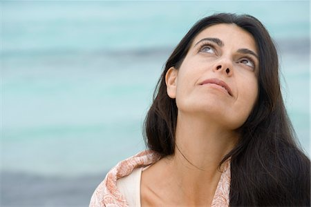 Woman at the beach, looking up Stock Photo - Premium Royalty-Free, Code: 632-05845617