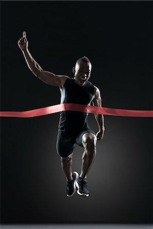 finish line - Runner crossing finish line Stock Photo - Premium Royalty-Free, Code: 632-05845646