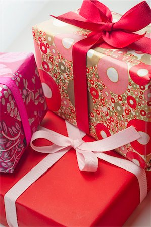 present wrapped close up - Festively wrapped gifts Stock Photo - Premium Royalty-Free, Code: 632-05991115