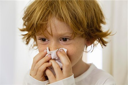 people coughing or sneezing - Boy blowing nose on tissue Stock Photo - Premium Royalty-Free, Code: 632-05991126