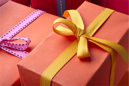 present wrapped close up - Festively wrapped gifts Stock Photo - Premium Royalty-Free, Code: 632-05991151
