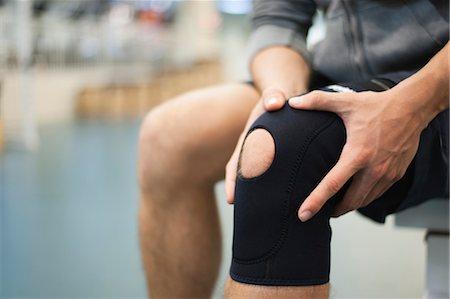 Man wearing knee brace, cropped Stock Photo - Premium Royalty-Free, Code: 632-05991197