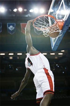 Basketball player slam dunking basketball Stock Photo - Premium Royalty-Free, Code: 632-05991200