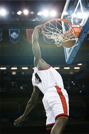 Basketball player slam dunking basketball Stock Photo - Premium Royalty-Free, Code: 632-05991200