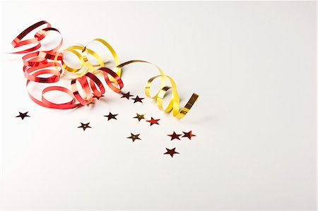 Confetti and gift-wrap ribbon Stock Photo - Premium Royalty-Free, Code: 632-05991271