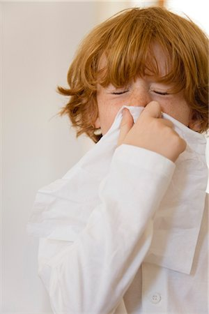 people coughing or sneezing - Boy blowing nose on tissue with eyes closed Stock Photo - Premium Royalty-Free, Code: 632-05991290