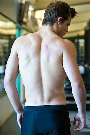 shirtless men - Barechested mascular man, rear view Stock Photo - Premium Royalty-Free, Code: 632-05991312