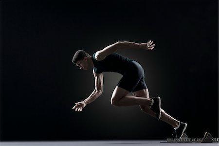 runner (male) - Runner leaving starting block Stock Photo - Premium Royalty-Free, Code: 632-05991438