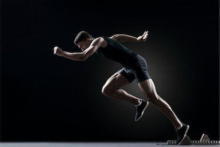 runner (male) - Runner leaving starting block Stock Photo - Premium Royalty-Free, Code: 632-05991508